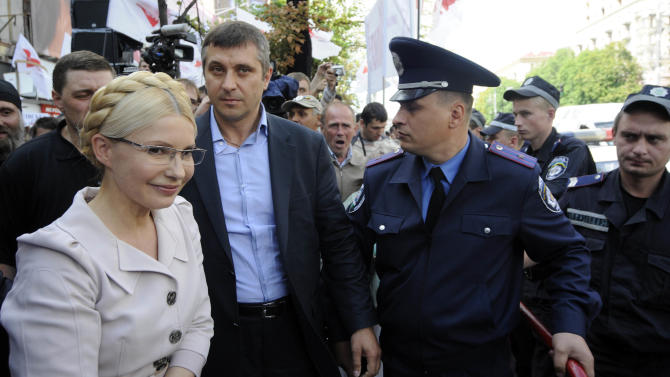 Former Ukrainian Prime Minister Yulia Tymoshenko is seen at the Pecherskiy District Court in Kiev, Wednesday, July 6, 2011. The Ukrainian security service says it has opened a criminal investigation into the activities of an energy company once headed by former Prime Minister Yulia Tymoshenko. Tymoshenko, the country's top opposition leader, is already on trial on charges she abused her office in signing a natural gas import deal with Russia in 2009. Tymoshenko denies the accusations and says the trial is an attempt by President Viktor Yanukovych to bar her from politics. (AP Photo/Sergei Chuzavkov)