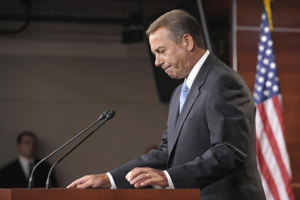 House Speaker John Boehner of Ohio arrives to speak to reporters on Capitol Hill in Washington, Monday, July 11, 2011, as the debt talks continued. (AP Photo/Susan Walsh)