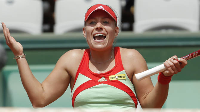 Angelique Kerber of Germany gestures in her quarter final match against Sara Errani of Italy at the French Open tennis tournament in Roland Garros stadium in Paris, Tuesday June 5, 2012. (AP Photo/Bernat Armangue)