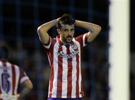 Atletico Madrid's Villa reacts during their Spanish first division soccer match against Celta Vigo at the Balaidos stadium in Vigo