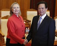 US Secretary of State Hillary Clinton (L) and Vietnam's Prime Minister Nguyen Tan Dung shake hands at the Government Office in Hanoi. Clinton made a strong push for improved human rights
