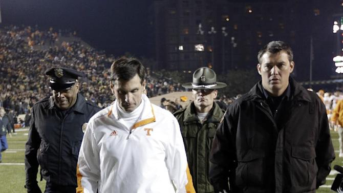 Tennessee head coach Derek Dooley, foreground, leaves the field after losing to Vanderbilt in an NCAA college football game on Saturday, Nov. 17, 2012, in Nashville, Tenn. Vanderbilt won 41-18. (AP Photo/Mark Humphrey)