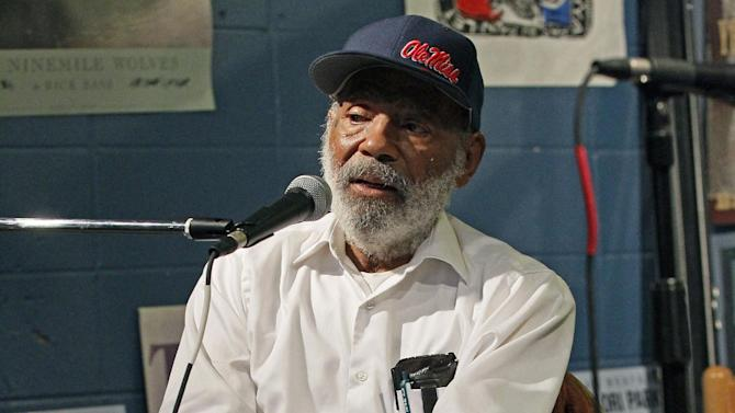 In this Aug. 14, 2012 photograph, James Meredith, the first black student to integrate the University of Mississippi in 1962 speaks about his latest book at a Jackson, Miss., book store. The book outlines his impression of race relations, integration and the statue the university erected to commemorate his integration of the liberal arts school. (AP Photo/Rogelio V. Solis)