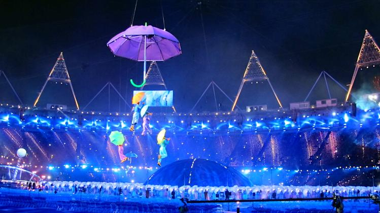 Performers dance with umbrellas during the Opening Ceremony for the 2012 Paralympics in London, Wednesday Aug. 29, 2012. (AP Photo)