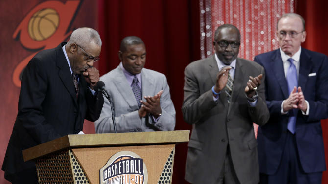 Seven-time NBA basketball All-Star Chet Walker, left, reacts as Isaiah Thomas, from left, Earl Monroe and Billy Cunningham applaud during the enshrinement ceremony for the 2012 class of the Naismith Memorial Basketball Hall of Fame at Symphony Hall in Springfield, Mass. Friday, Sept. 7, 2012. (AP Photo/Elise Amendola)