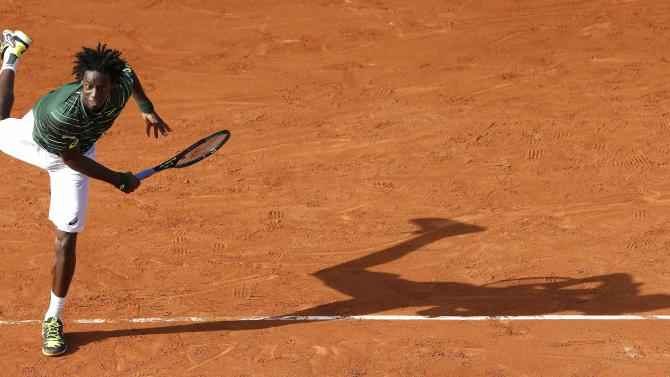 Gael Monfils of France serves to compatriot Edouard-Roger Vasselin during their men's singles match at the French Open tennis tournament at the Roland Garros stadium in Paris