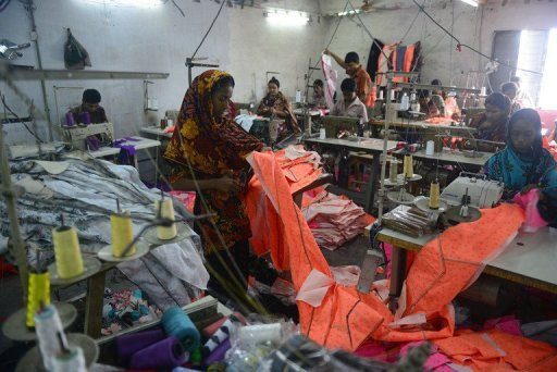 Bangladeshi labourers work in a small garment factory on the outskirts of Dhaka, on May 29, 2013. Hundreds of employees of a Bangladesh garment factory near Dhaka have fallen sick after drinking suspected contaminated water in their workplace, police and factory officials told AFP.