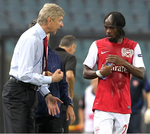 Arsenal's coach Arsène Wenger talks to striker Gervinho of the Ivory Coast, during a Champions League qualifying playoff second leg soccer match against Udinese in Udine, Italy, Wednesday, Aug. 24, 2011. Arsenal won 2-1 and advances 3-1 on aggregate. (AP Photo/Paolo Giovannini)