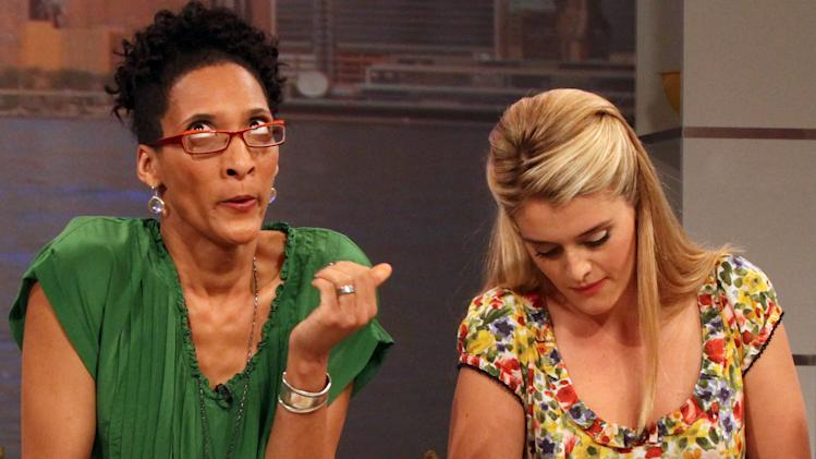 "This Friday, Aug. 26, 2011 photo shows co-hosts Carla Hall, left, and Daphne Oz as they prepare a dish during a rehearsal for ABC's ""The Chew"" in New York. Can some of food and style TV's biggest stars help ABC soap fans get over cancellation of their favorite stories? The network's counting on it for ""The Chew.""     (AP Photo/Tina Fineberg)"