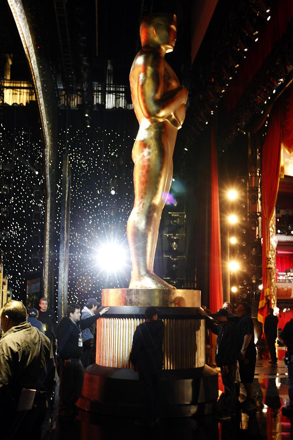 An Oscar statue is moved during rehearsals for Sunday's 84th Academy Awards, Saturday, Feb 25, 2012 in Los Angeles. (AP Photo/Chris Carlson)