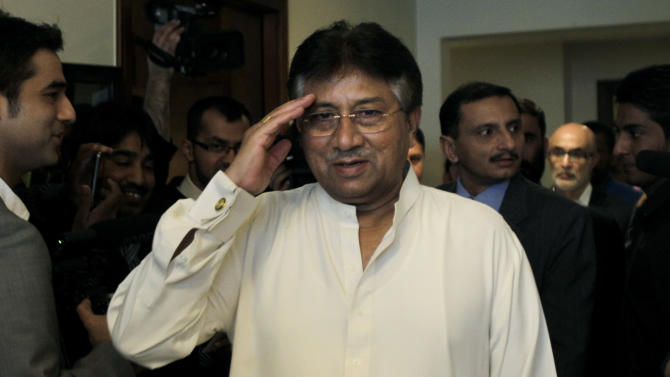 Former Pakistani President Pervez Musharraf salutes journalists as he arrives in his office for a press briefing before leaving to Karachi in Dubai, United Arab Emirates, Sunday, March 24, 2013. Musharraf gathered Sunday with supporters at Dubai's international airport for his planned return to his homeland after more than four years in self-exile.  (AP Photo/Kamran Jebreili)