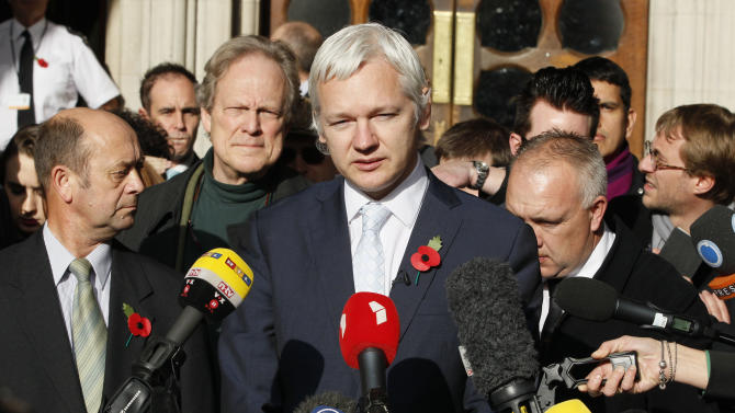 FILE - In this Nov. 2, 2011, file photo, the founder of WikiLeaks Julian Assange, center, gives a statement to the media after his extradition hearing at the High Court in London. Ecuador accused Britain on Wednesday, Aug. 15, 2012, of threatening to storm its London embassy to arrest Assange after the U.K. issued a stern warning to the South American nation ahead of its decision on an asylum bid by the WikiLeaks founder. (AP Photo/Kirsty Wigglesworth, file)