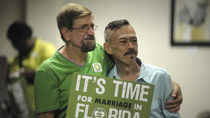 Gibbons and Vargas of Oakland Park participate in the Decision Day Celebration Rally at the Pride Center, in Wilton Manors