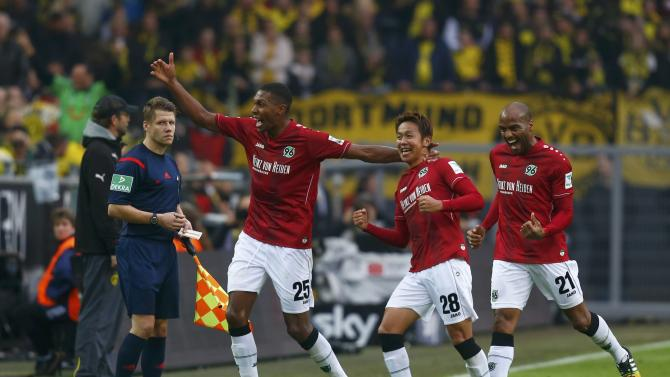 Hanover 96's Kiyotake celebrates with team mates after socing a goal against Borussia Dortmund during Bundesliga soccer match in Dortmund