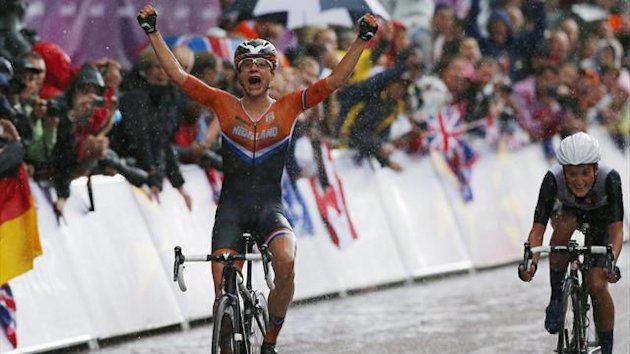 Netherlands' Marianne Vos (L) reacts as she crosses the finish line ahead of Britain's Elizabeth Armitstead to win the women's cycling road race final at the London 2012 Olympic Games (Reuters)
