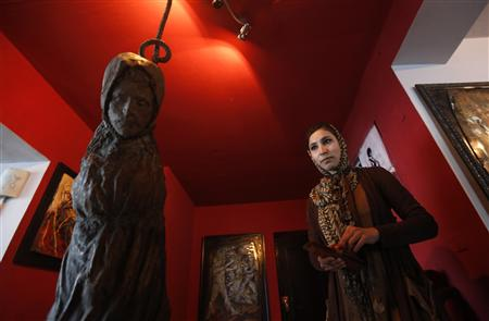 Afghan artist Malina Suliman is pictured inside The Venue art gallery in Kabul