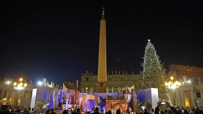 The Vatican Christmas tree and a traditional Crib are lit up after a ceremony in Saint Peter's Square at the Vatican