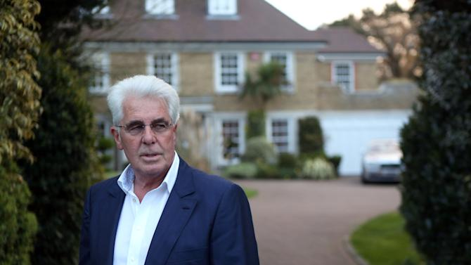 Publicist Max Clifford speaks to the media outside his home in Hersham south eastern England, after he was charged with 11 historic counts of indecent assault against teenage girls, Friday April 26, 2013. The charges come as part of a broad investigation into child sex abuse spurred by the scandal involving the late BBC personality Jimmy Savile. Prosecutors said Friday the charges against Clifford relate to assaults allegedly committed between 1966 and 1985 and involve seven complainants who were between the ages of 14 and 19 at the times of the alleged assaults.  (AP Photo/PA, Steve Parsons)  UNITED KINGDOM OUT  NO SALES  NO ARCHIVE