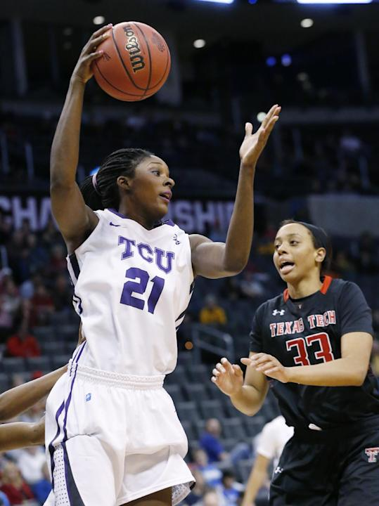 TCU center Latricia Lovings (21) grabs a rebound in front of Texas Tech forward Shauntal Nobles (33) in the second half of an NCAA college basketball game in the Big 12 women's tournament in Oklah