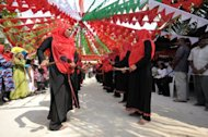 Maldivian women perform a traditional dance on Kaashidoo island in March. A court in the Maldives has ordered a public flogging for a 16-year-old girl who confessed to having pre-marital sex, in a ruling that Tuesday triggered widespread criticism from rights groups