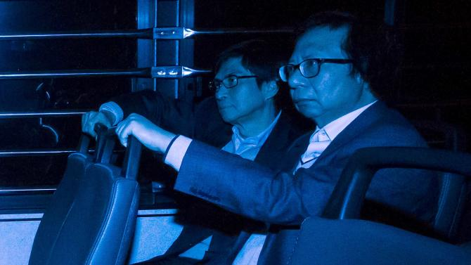 Former Sun Hung Kai Properties executive Chan, and Kwok, former co-chairman of Sun Hung Kai Properties, sit in a prison van as they leave the High Court in Hong Kong
