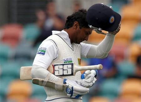 Sri Lanka's Sangakkara walks off ground after he was dismissed by Australia's Siddle during first test cricket match in Hobart