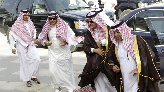 "Saudi Foreign Minister Prince Saud al-Faisal, second right, seen upon his arrival with his bodyguards to the foreign ministers of the Gulf Cooperation Council ""GCC""  meeting in Riyadh, Saudi Arabia, Sunday, May 13, 2012. Gulf leaders will discuss a proposal for a closer political union, which Bahrain said could be modelled on the European Union. The union idea will be on the agenda of the consultative summit of the GCC countries to be hosted by Riyadh on Monday. (AP Photo/Hassan Ammar)"