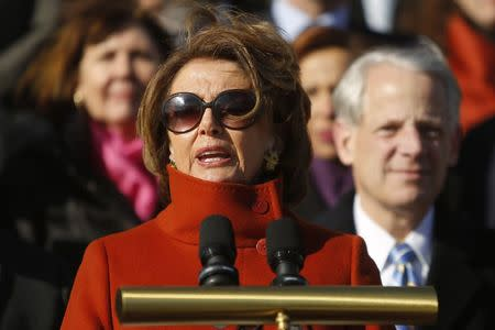 Pelosi, standing with fellow House Democrats, delivers remarks on immigration legislation on the steps of the U.S. Capitol in Washington