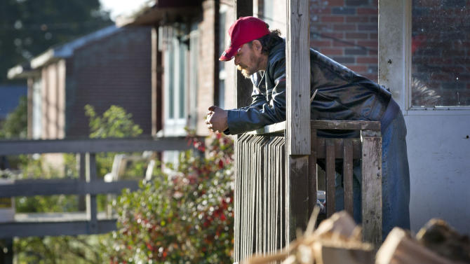 In this photo made Danny Newell, an unemployed former logger, hangs out at his home Wednesday, Oct. 2, 2013, in Indian Township, Maine. The latest figures from the federal Bureau of Indian Affairs put unemployment on the Passamaquoddy reservation at an astonishing 60 percent, causing an exodus of tribal members. (AP Photo/Robert F. Bukaty)