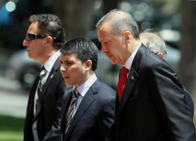 Turkish Prime Minister Recep Tayyip Erdogan, right, arrives for a cabinet meeting in his office in Ankara, Turkey, Monday, June 25, 2012. Upon Turkey&#39;s request, NATO will hold a meeting Tuesday in Brussels over article 4 of its charter concerning Friday&#39;s incident, when a Turkish warplane was shot down by Syria. Syria&#39;s Foreign Ministry spokesman Jihad Makdissi said Monday his country has &quot;no hostility&quot; toward Turkey as tensions soar between the former allies three days after Syria shot down a Turkish plane. (AP Photo)