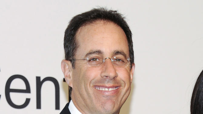 """FILE - This Oct. 24, 2011 file photo shows comedian Jerry Seinfeld attending """"Lincoln Center Presents: An Evening With Ralph Lauren"""" at Alice Tully Hall in New York. Seinfeld announced Thursday, July 5, 2012, that he'll debut the Web series """"Comedians in Cars Getting Coffee"""" on July 19. The interview show will feature Seinfeld's comedian friends as guests. In a teaser video, Seinfeld is shown driving various vintage cars with Larry David, Ricky Gervais, Michael Richards, Alec Baldwin and others. The show is presented by Crackle, the digital network owned by Sony Pictures Entertainment. (AP Photo/Evan Agostini, file)"""
