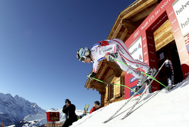Austria's Hannes Reichelt starts during a men's alpine skiing World Cup downhill training session in Wengen, Switzerland, Thursday Jan. 12, 2012. (AP Photo/Marco Trovati)