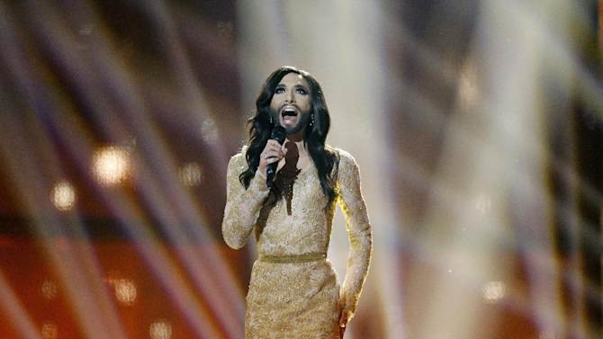 Singer Conchita Wurst representing Austria performs the song 'Rise Like a Phoenix' during the final of the Eurovision Song Contest in the B&W Halls in Copenhagen, Denmark, Saturday, May 10, 2014. (AP Photo/Frank Augstein)