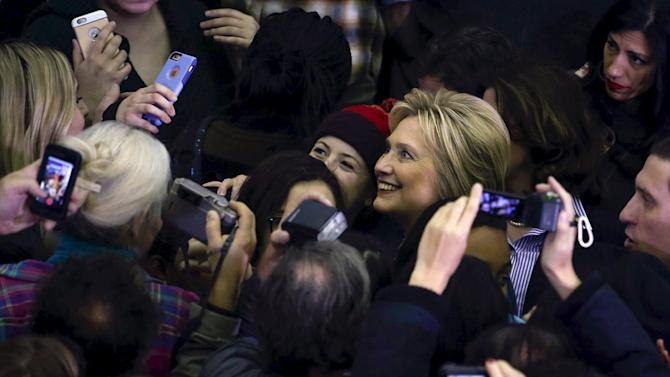 Democratic U.S. presidential candidate Hillary Clinton poses with supporters after holding a student town hall during a campaign stop in Henniker, New Hampshire