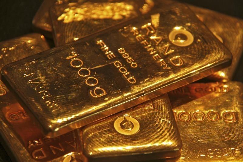 Gold turns lower after nearing 15-month high as dollar firms