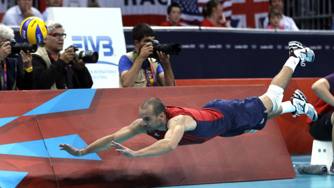 United States' Donald Suxho dives but cannot reach a ball during a men's quarterfinal volleyball match against Italy at the 2012 Summer Olympics, Wednesday, Aug. 8, 2012, in London. (AP Photo/Jeff Roberson)