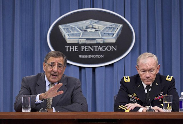 FILE - In this June 29, 2012 file photo, Defense Secretary Leon Panetta, left, accompanied by Joint Chiefs Chairman Gen. Martin Dempsey, gestures during a news conference at the Pentagon. Top Pentagon leaders say have talked by phone with their new Egyptian counterparts and are hoping to continue the longtime military relationship between Washington and Cairo. Egyptian President Mohammed Morsi shook up his nation's military over the weekend, replacing two men who'd had strong working relationships with the Pentagon. (AP Photo/Evan Vucci)