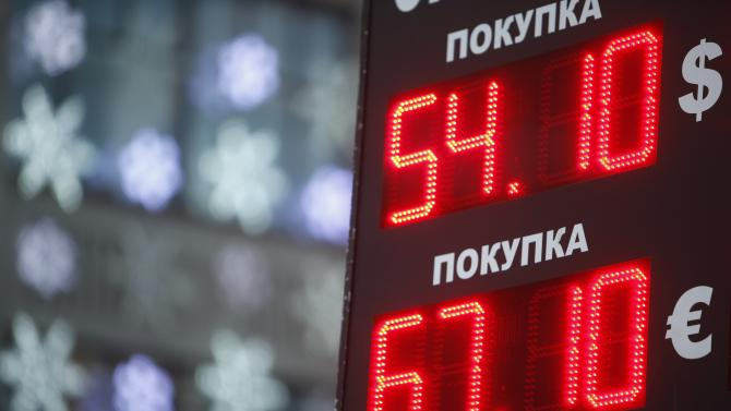 Board showing currency exchange rates is on display in Moscow