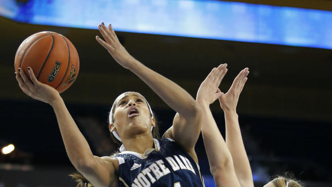 FILE - In this Nov. 23, 2012 file photo, Notre Dame guard Skylar Diggins, left, puts up a shot against UCLA guard Kari Korver during the first half of an NCAA women's college basketball game in Los Angeles. Diggins was selected to the 2012-13 AP Women's All-America team, Tuesday, April 2, 2013.  (AP Photo/Jae C. Hong, File)