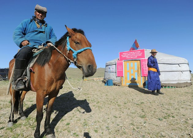 A nomad voter arrives at a yurt temporarily serving as a polling station in Hovt, western Mongolia, Thursday, June 28, 2012. Mongolians are voting for a new legislature, going to the polls by foot, car and even horse for an election centered on how best to distribute the benefits of Mongolia&#39;s mining boom. (AP Photo/Kyodo News) JAPAN OUT, MANDATORY CREDIT, NO LICENSING IN CHINA, HONG KONG, JAPAN, SOUTH KOREA AND FRANCE
