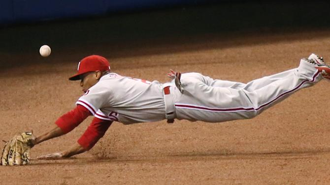 Philadelphia Phillies left fielder Ben Revere dives after a double by St. Louis Cardinals' Matt Carpenter in fifth inning action during a baseball game between the St. Louis Cardinals and the Philadelphia Phillies on Monday, April 27, 2015, at Busch Stadium in St. Louis. (Chris Lee/St. Louis Post-Dispatch via AP)  EDWARDSVILLE INTELLIGENCER OUT; THE ALTON TELEGRAPH OUT; MANDATORY CREDIT