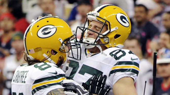Green Bay Packers tight end Tom Crabtree (83) celebrates after wide receiver Jordy Nelson (87) scored a touchdown as Houston Texans cornerback Johnathan Joseph (24) leaves the field in the first quarter of an NFL football game, Sunday, Oct. 14, 2012, in Houston. (AP Photo/Dave Einsel)