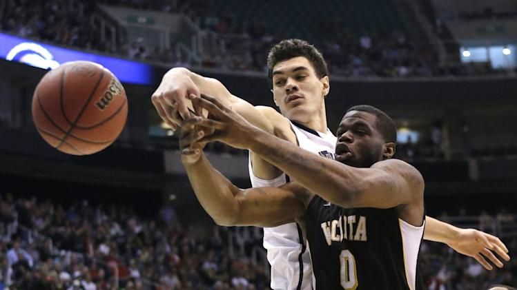 Wichita State's Chadrack Lufile (0) and Pittsburgh's Steven Adams (13) go after a rebound in the first half during a second round game in the NCAA college basketball tournament in Salt Lake City Thursday, March 21, 2013. (AP Photo/Rick Bowmer)