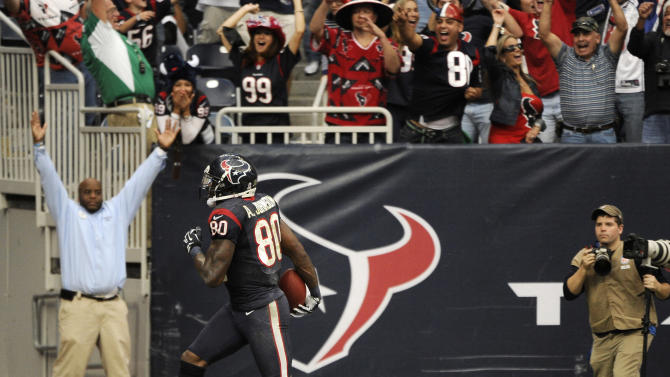 Houston Texans wide receiver Andre Johnson scores the winning touchdown against the Jacksonville Jaguars in overtime of an NFL football game Sunday, Nov. 18, 2012, in Houston. The Texans won 43-37. (AP Photo/Dave Einsel)