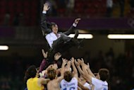 S.Korea's players celebrate with coach Hong Myung Bo (top) defeating Japan to win the bronze medal in the men's football at the London 2012 Olympic Games, on August 10, at the Millenium stadium in Cardiff. S.Korea won 2-0