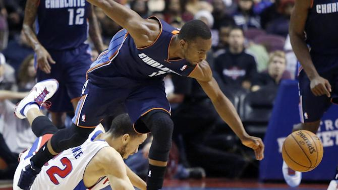 Charlotte Bobcats guard Kemba Walker, front, steals the ball from Detroit Pistons forward Tayshaun Prince (22) in the first half of an NBA basketball game, Sunday, Jan. 6, 2013, in Auburn Hills, Mich. (AP Photo/Duane Burleson)