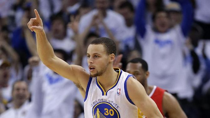 Golden State Warriors' Stephen Curry (30) celebrates after making a 3-pointer against the Los Angeles Clippers during the first half of an NBA basketball game in Oakland, Calif., Wednesday, Jan. 2, 2013. (AP Photo/Marcio Jose Sanchez)