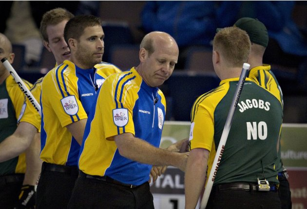 Alberta skip Martin and teammate Morris shake hands after losing to Northern Ontario skip Jacobs during the Canadian Men's Curling Championshipsin Edmonton