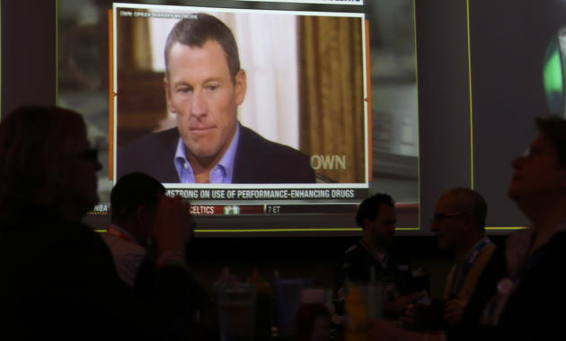 FILE - A video screen at a hotel restaurant in Grapevine, Texas on Friday, Jan. 18, 2013 shows a replay telecast of Lance Armstrong being interviewed by Oprah Winfrey, Reversing more than a decade of