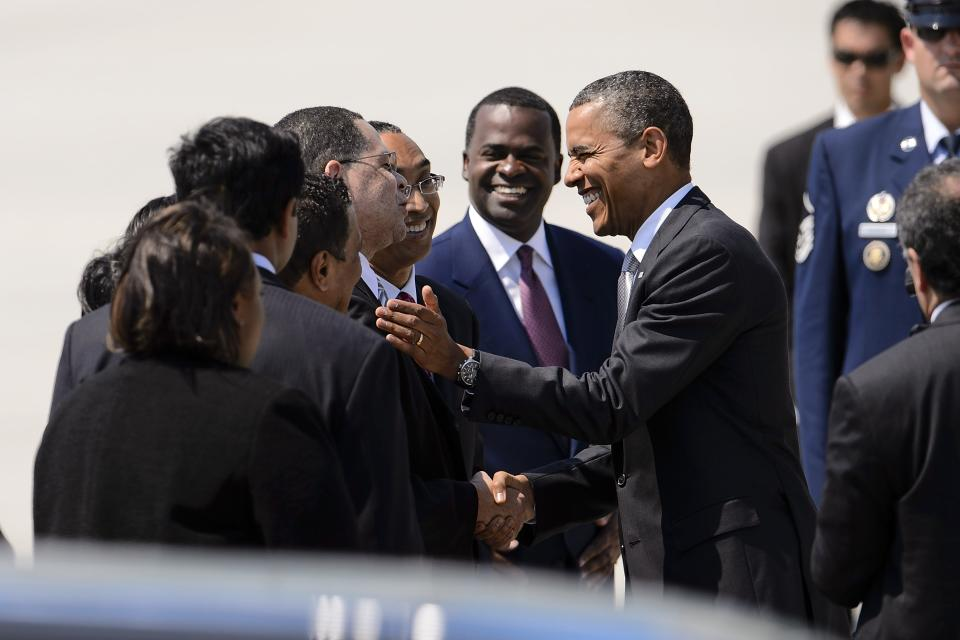 President Barack Obama shakes hands with Fulton County, Ga., Chairman John Eaves as Dekalb County, Ga., CEO Burrell Ellis and Atlanta Mayor Kasim Reed look on, upon Obama's arrival on Air Force One at Hartsfield-Jackson Atlanta International Airport, Tuesday, June 26, 2012, in Atlanta. (AP Photo/Paul Abell)
